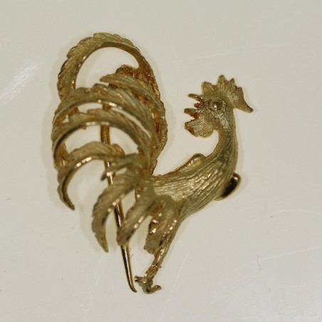 Broche coq en or.